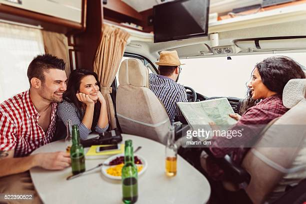 Friends on a roadtrip with campervan