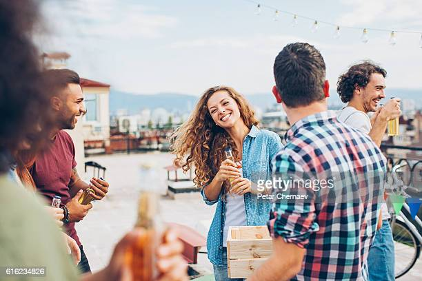 Friends on a rooftop party
