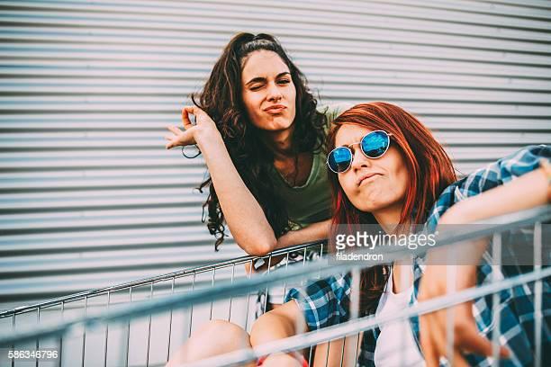 Friends on a shopping cart