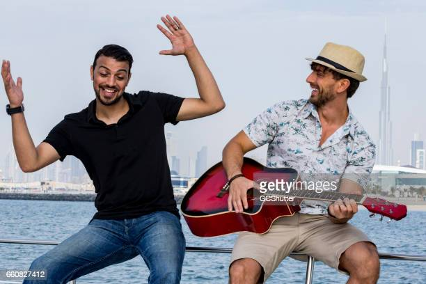 Friends on a yacht enoying their weekend in Dubai