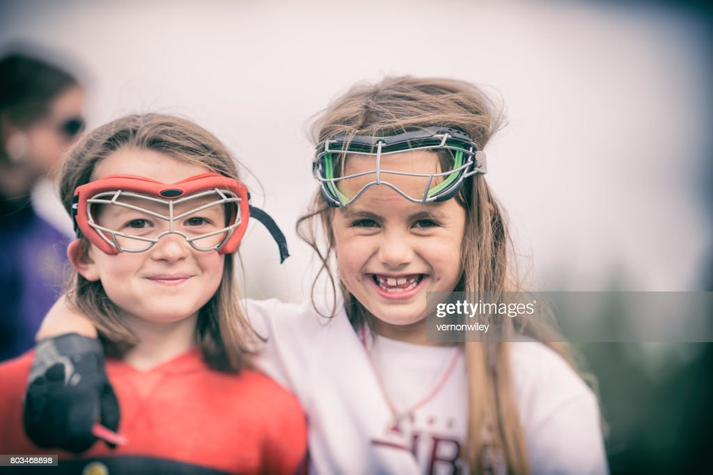 Girls learning to play Lacrosse
