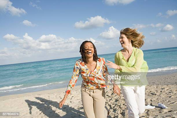 friends on beach - vintage lesbian photos stock pictures, royalty-free photos & images