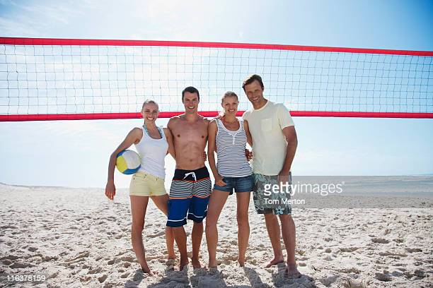 Friends on beach volleyball court