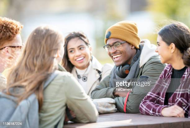 friends on campus - college student stock pictures, royalty-free photos & images