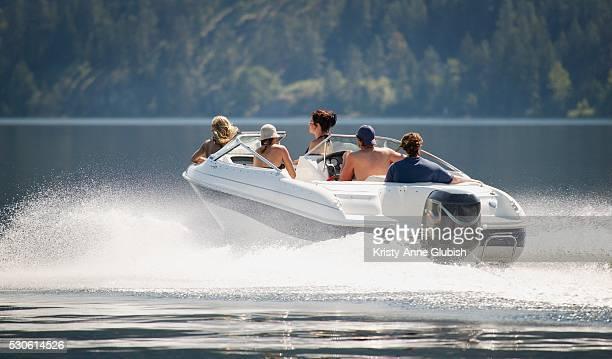 Friends on Motorboat in Lake