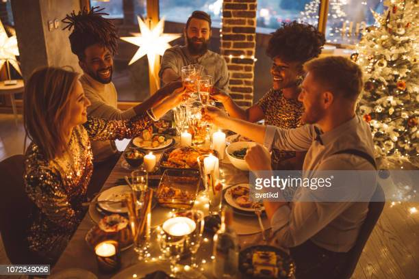 friends on new year dinner party - evening meal stock pictures, royalty-free photos & images