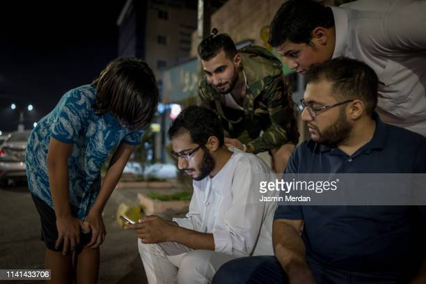 friends on night street on phone - jordan middle east stock pictures, royalty-free photos & images