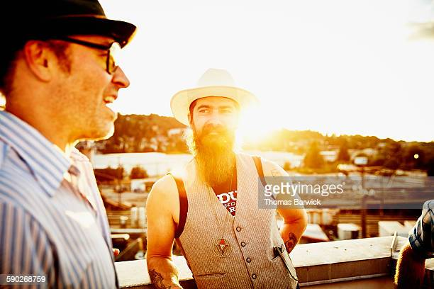 Friends on rooftop on summer evening