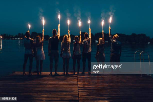 friends on summer party - sparkler stock photos and pictures