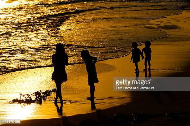 Friends on sunset beach