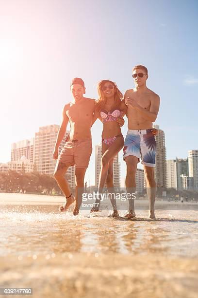Friends on the beach enjoying hot summer