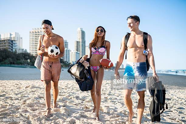 Friends on the beach enjoying hot summer