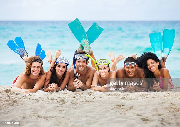Friends on the beach ready to snorkeling