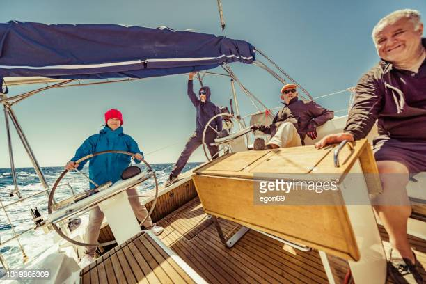 friends on the sailing boat - sailor suit stock pictures, royalty-free photos & images