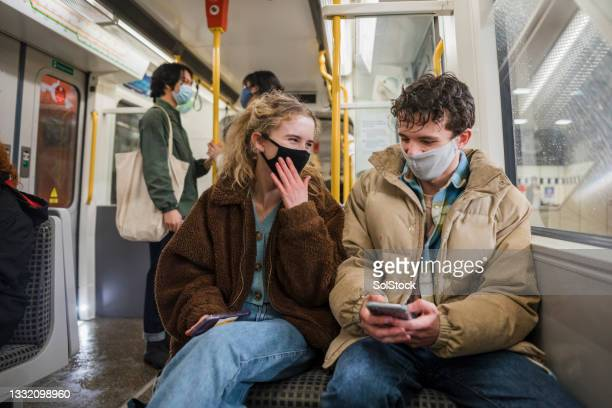 friends on the subway together - person in education stock pictures, royalty-free photos & images
