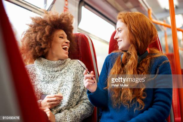 Friends on train, London