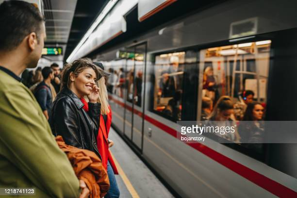 friends on train station - railway station stock pictures, royalty-free photos & images