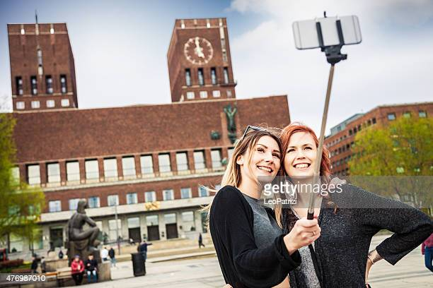 Friends on travel taking a selfie on mobile