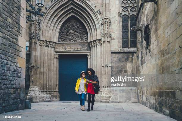 friends on winter holidays in spain - female friendship stock pictures, royalty-free photos & images