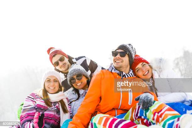 friends on winter vacation - ski pants stock pictures, royalty-free photos & images