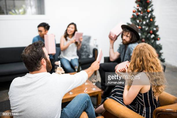 Friends opening Christmas presents