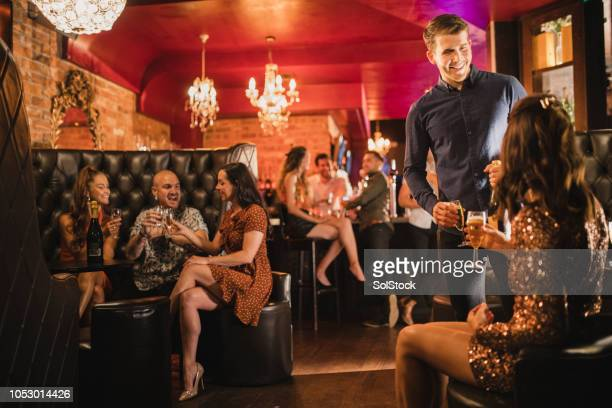 friends out drinking and socialising with one another - party social event stock pictures, royalty-free photos & images