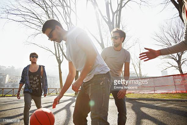 Friends outdoor playing basketball