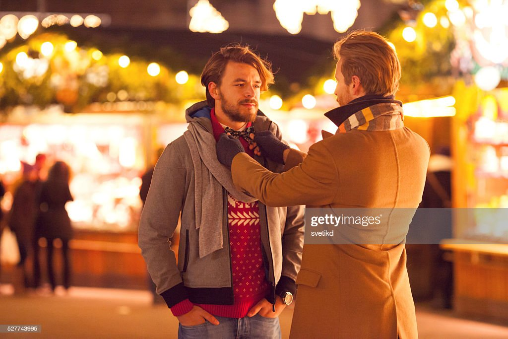 Friends outdoors at winter fair. : Stock Photo