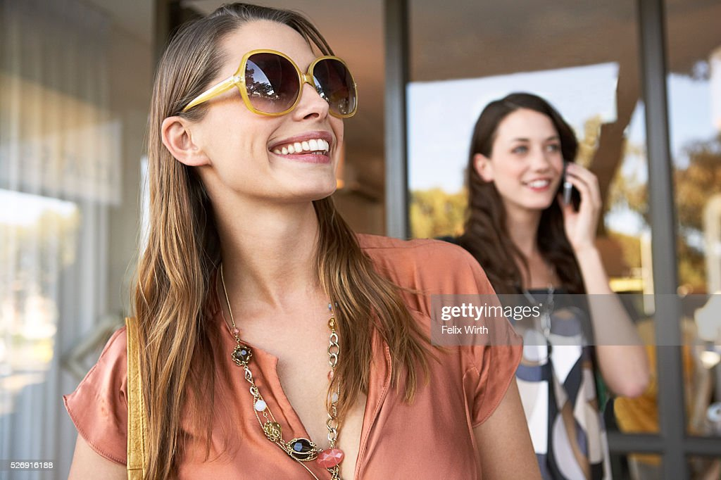 Friends outside boutique : Stock Photo