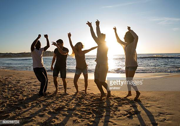 Friends partying at the beach