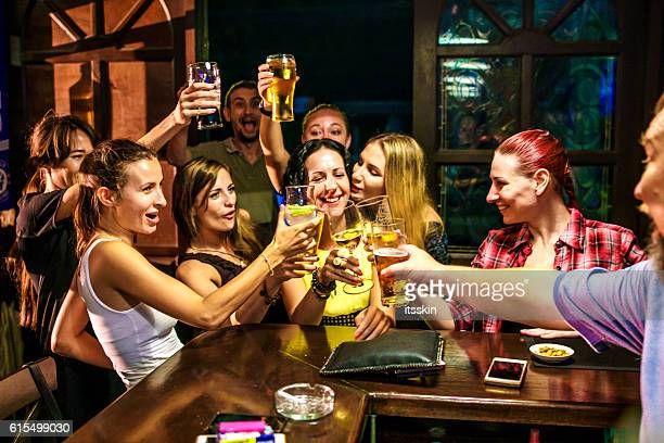 Friends partying in the bar