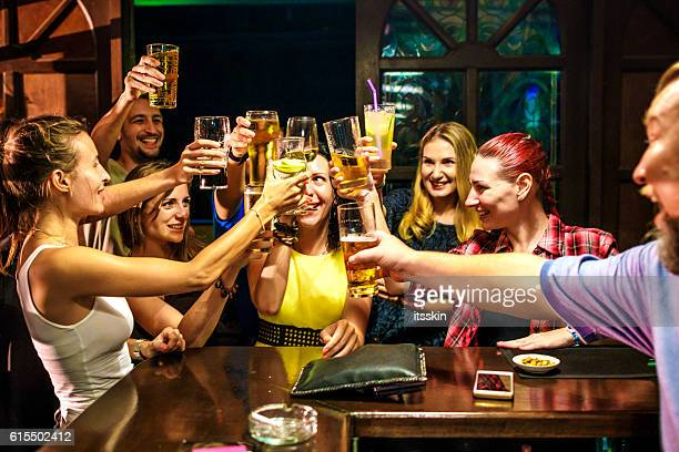 friends partying in the bar - binge drinking stock photos and pictures