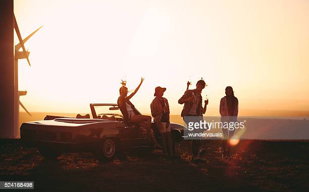 Friends partying outdoors on Road Trip during a summer evening