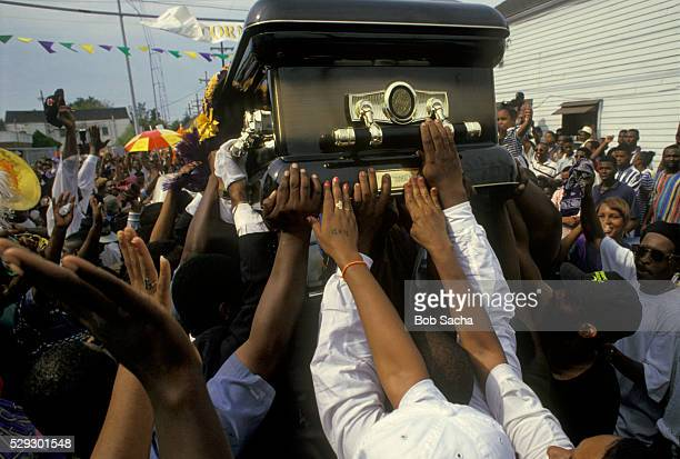 friends passing casket through neighborhood - pallbearer stock pictures, royalty-free photos & images