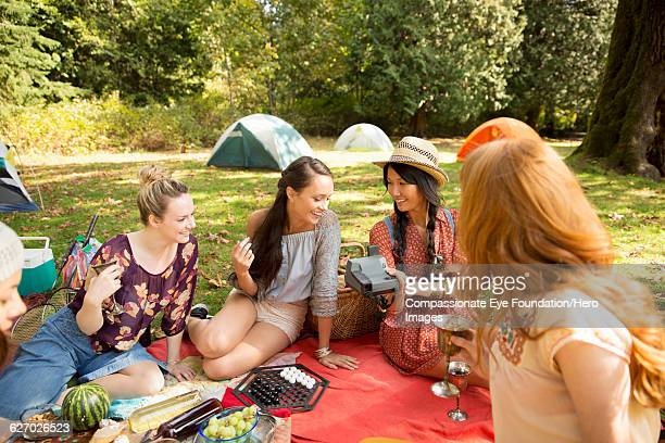 Friends picnicking together in park