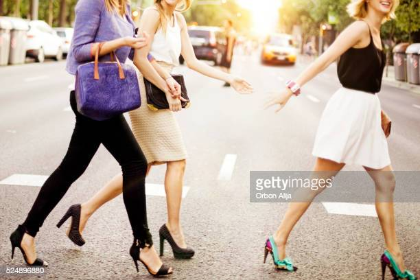 friends - beautiful legs in high heels stock photos and pictures
