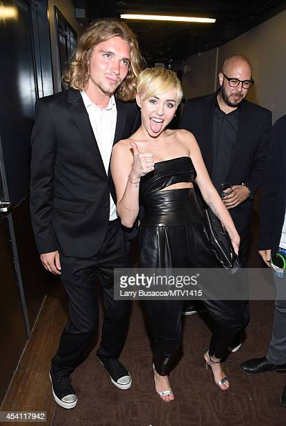 Friend's Place representative Jesse Helt and singer Miley Cyrus attend the 2014 MTV Video Music Awards at The Forum on August 24 2014 in Inglewood...