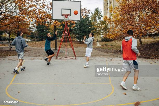 friends play basketball - amateur stock pictures, royalty-free photos & images