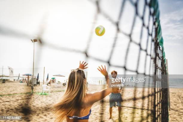 friends play beach volley and have fun - beach volleyball stock pictures, royalty-free photos & images