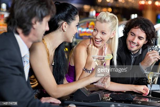 friends  play in the casino on electronic roulette