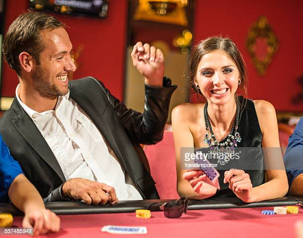 friends playing at poker at casino - poker card game stock photos and pictures