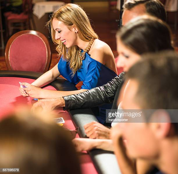 friends playing at poker at casino - texas hold 'em stock pictures, royalty-free photos & images