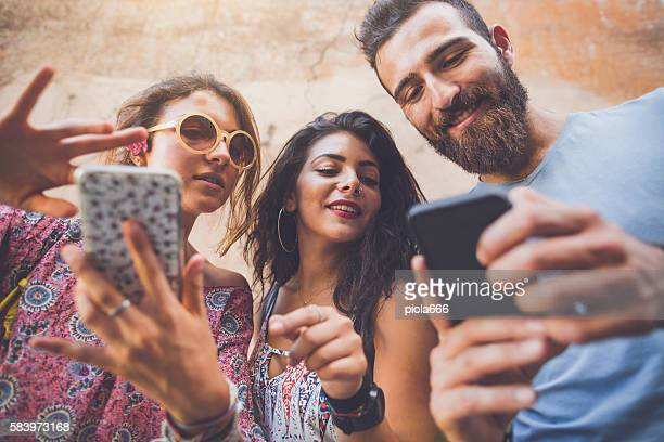 friends playing augmented reality mobile game - gambling stock pictures, royalty-free photos & images