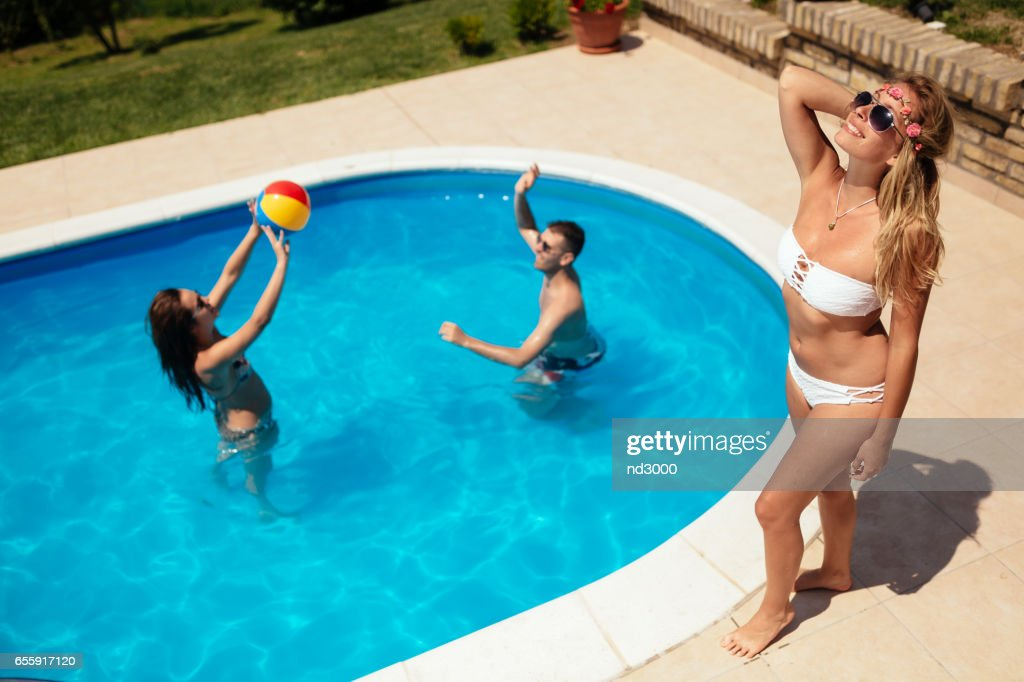 Friends Playing Ball Games In Swimming Pool Stock Photo   Getty Images