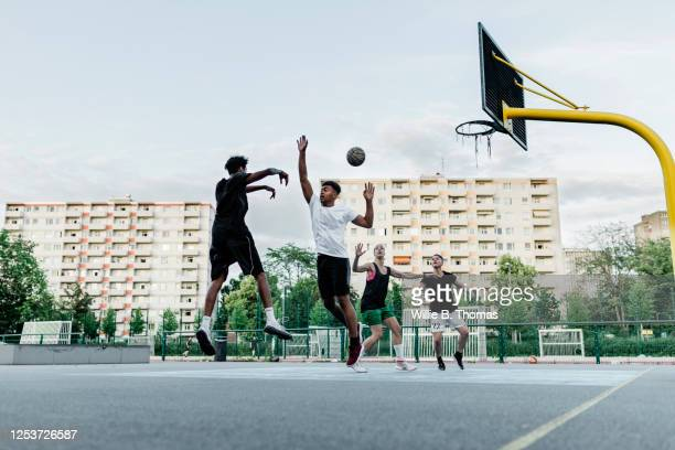 friends playing basketball - try scoring stock pictures, royalty-free photos & images