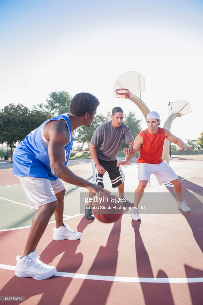 Friends playing basketball : Stock Photo