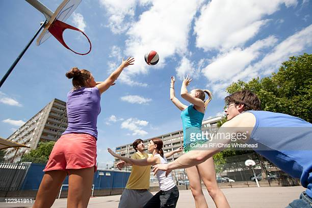 friends playing basketball together - making a basket scoring stock pictures, royalty-free photos & images