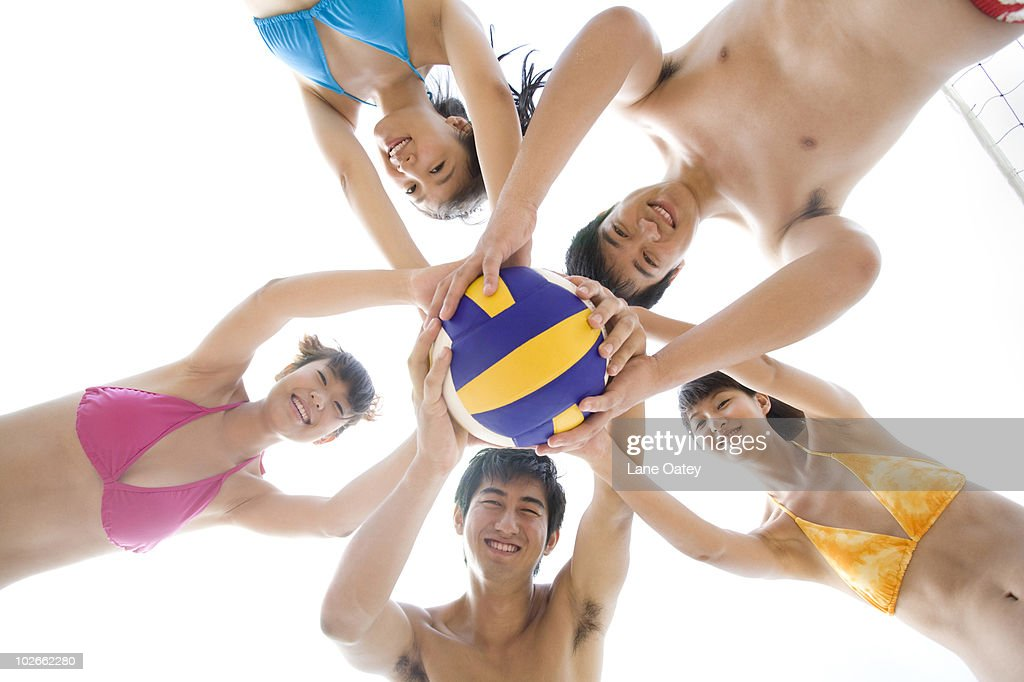 Friends Playing Beach Volleyball Stock Photo - Getty Images