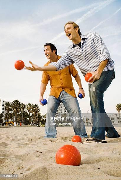 Friends playing bocce ball on beach,Santa Monica, California, USA