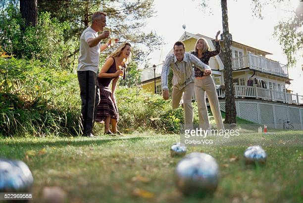 Friends Playing Bocce in Yard